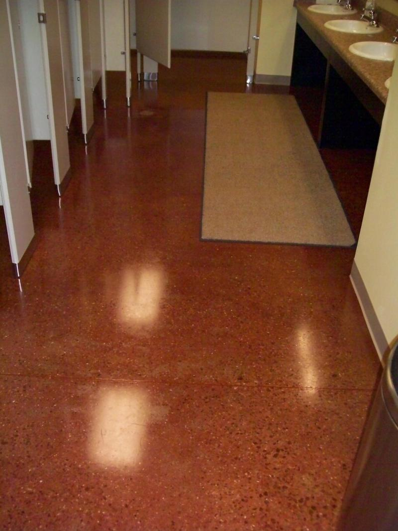 Ground concrete with exposed aggregate, saddle brown color and urethane sealer